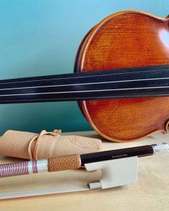 violin next to a carbon fiber violin bow