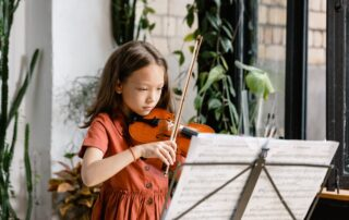 A diligent girl playing violin
